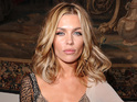 Abbey Clancy and Vanessa Feltz among guests at Julien Macdonald's runway show.