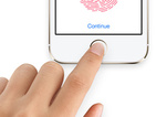 iPhone maker could be bringing its fingerprint scanner to its computer line.
