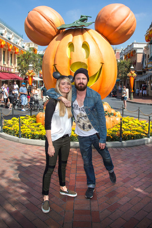 Actor Aaron Paul, Lauren Parsekian celebrates 'Halloween Time' at Disneyland September 17, 2013 in Anaheim, California. The 'Halloween Time' celebration at the Disneyland Resort, which features special attractions and entertainment, continues through October 31, 2013.