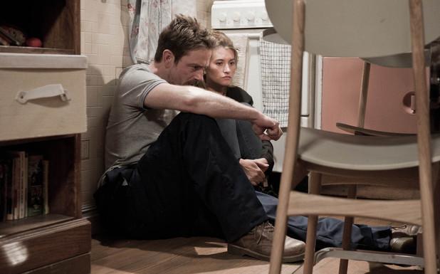 Cameron holds Debbie hostage