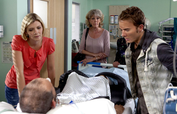 Leanne and David gather at Nick's bedside.