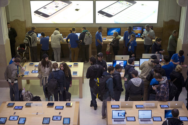 Customers shop for the new iPhones