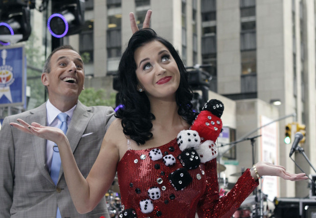 "NBC ""Today"" television program co-host Matt Lauer makes bunny ears behind the head of singer Katy Perry as she poses for photos after she performed, in New York Friday"