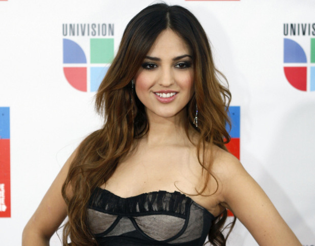 "Eiza Gonzalez poses for photographers on the red carpet as she goes in to record the Spanish language version of ""We Are The World"""