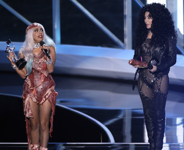 Lady Gaga, left, accepts the award for Video of the Year presented by Cher, right, at the 2010 MTV Video Music Awards in Los Angeles.