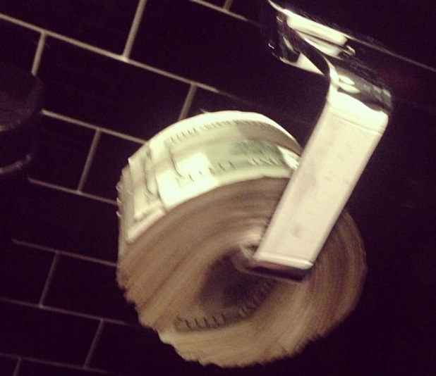 Scott Disick using money as toilet paper