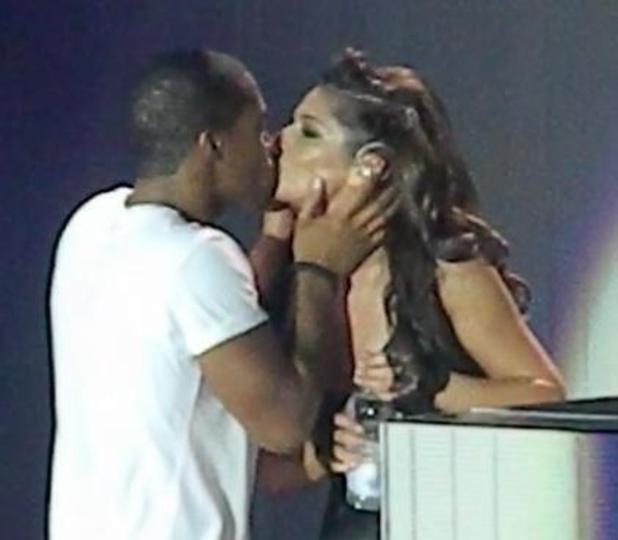 Tre Holloway and Cheryl Cole kiss on stage