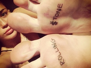 Miley Cyrus gets a 'Rolling $tone' tattoo