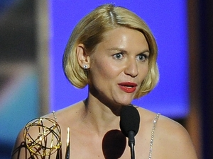 "Claire Danes accepts the award for outstanding lead actress in a drama series for her role on '""Homeland' at the 65th Primetime Emmy Awards"
