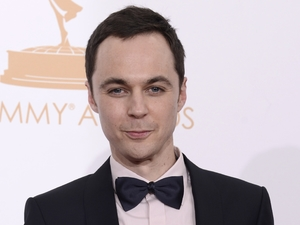 "Jim Parsons poses backstage with the award for outstanding lead actor in a comedy series for his role on 'The Big Bang Theory'"" at the 65th Primetime Emmy Awards"