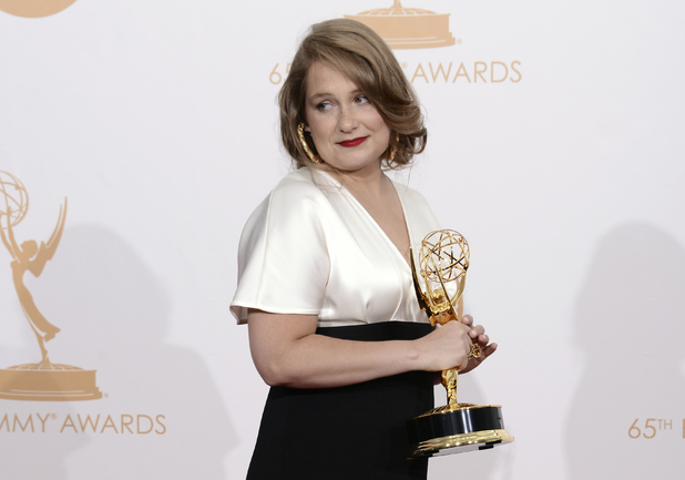 "Merritt Wever poses backstage with the award for outstanding supporting actress in a comedy series for her role in ""Nurse Jackie"" at the 65th Primetime Emmy Awards"