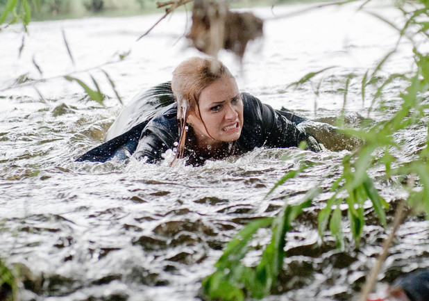 Amy jumps into the river in a bid to rescue Kyle