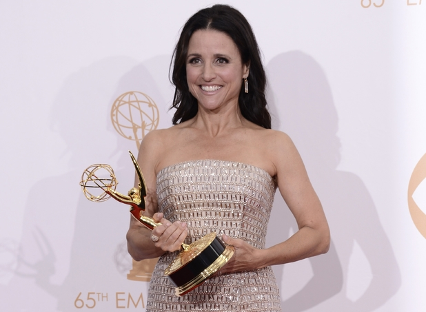 "Julia Louis-Dreyfus poses backstage with the award for outstanding lead actress in a comedy series for her role on 'Veep'"" at the 65th Primetime Emmy Awards"