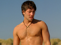 Rising star Jack Donnelly slips out of his armor ahead of Atlantis's launch.