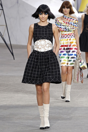 Miranda Kerr presents a creation as part of Chanel's ready-to-wear Spring/Summer 2014 fashion collection at Paris Fashion Week