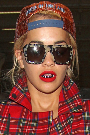 Rita Ora shows off her grill