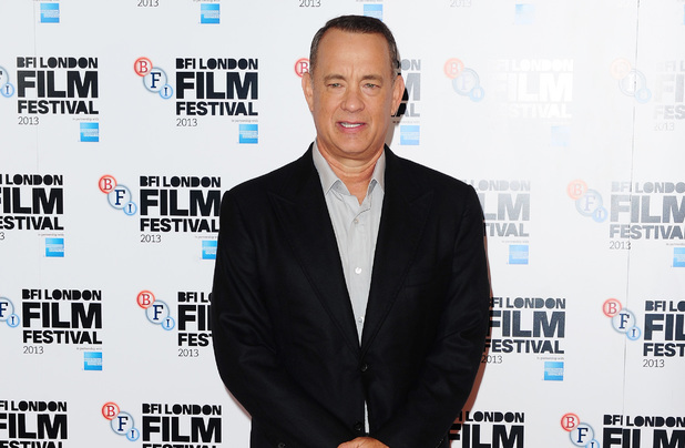Tom Hanks arrives at a photocall for new film Captain Phillips at the Mayfair Hotel, London.