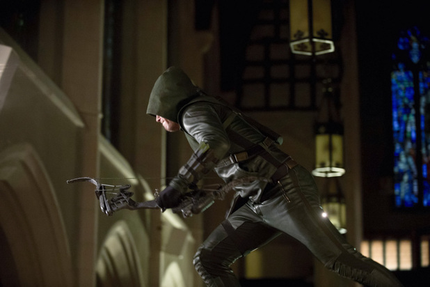 Stephen Amell as The Arrow in 'Arrow' S02E01: 'City of Heroes'