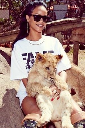 Rihanna cuddles a cub