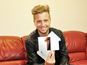 Lawson and Eminem achieve top five placings in this week's singles chart.