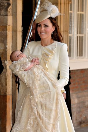 The Duchess of Camridge holds her son Prince George prior to the christening