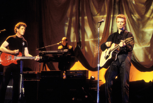 Lou Reed on stage with David Bowie for his 50th birthday concert in 1997
