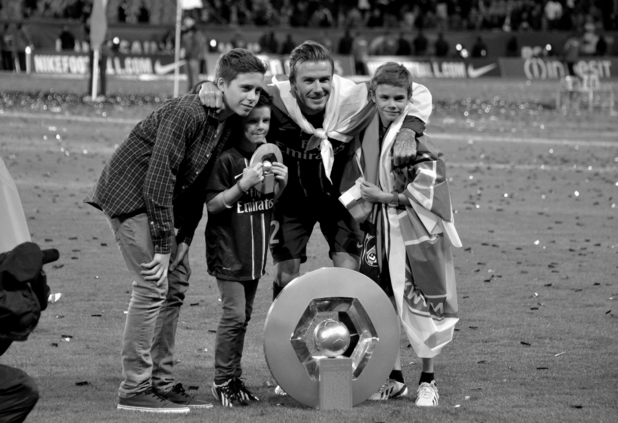 David Beckham and his sons Brooklyn, Romeo and Cruz in a photo taken from his book