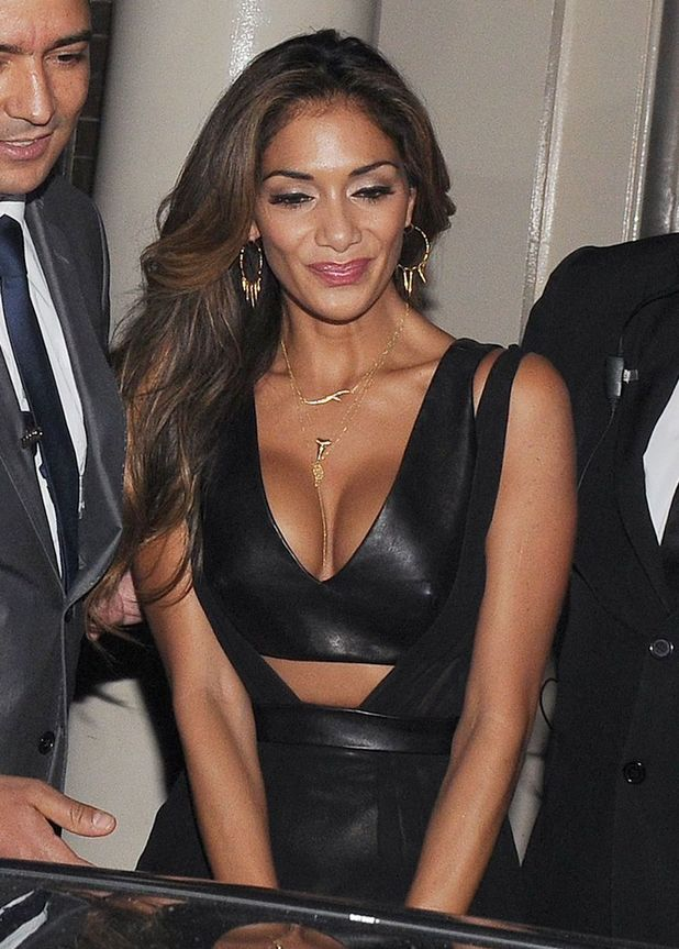 X Factor judge Nicole Scherzinger shows off her ample cleavage in a plunging leather dress as she leaves the Arts Club in London