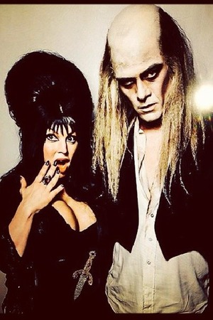 Josh Duhamel & Fergie dressed as Elvira and Riff Raff for Halloween.