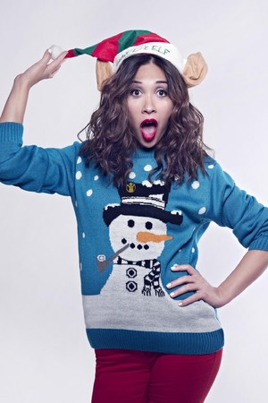 Myleene Klass posing for Save The Children's 'Christmas Jumper Day' campaign 2013
