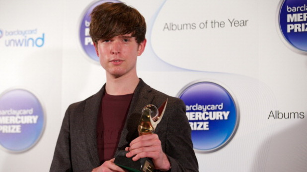 James Blake poses with Mercury Prize trophy
