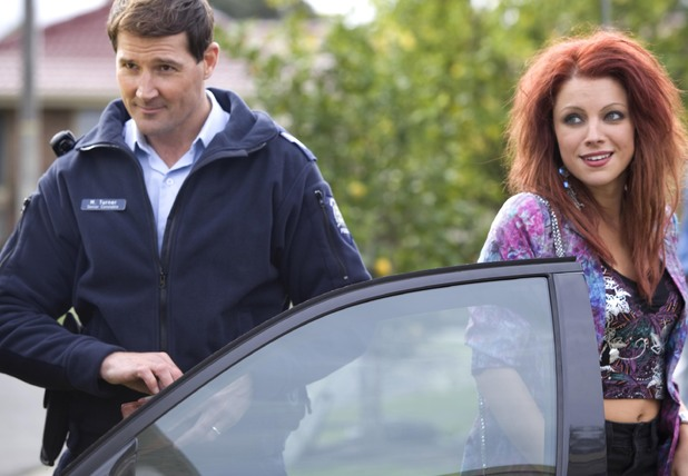 Rhiannon arrives back on Ramsay Street.