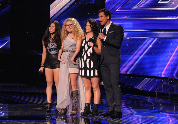 Mario Lopez with the three advancing girls on The X Factor USA first live show