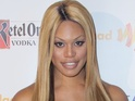 Laverne Cox reveals stories of growing up transgender in book.