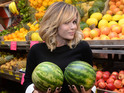Amanda Holden holds up a pair of watermelons at a grocery store book signing.