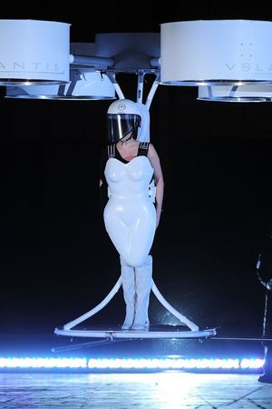 Lady Gaga demonstrating a flying dress designed by the House of Gaga titled Volantis
