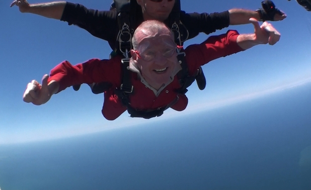 Steve triumphantly completes the skydive.