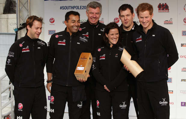 Prince Harry poses with Team UK during the Walking with the Wounded South Pole Allied Challenge departure in London
