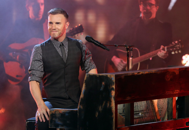 Gary Barlow leaves the judging panel to perform his new single.