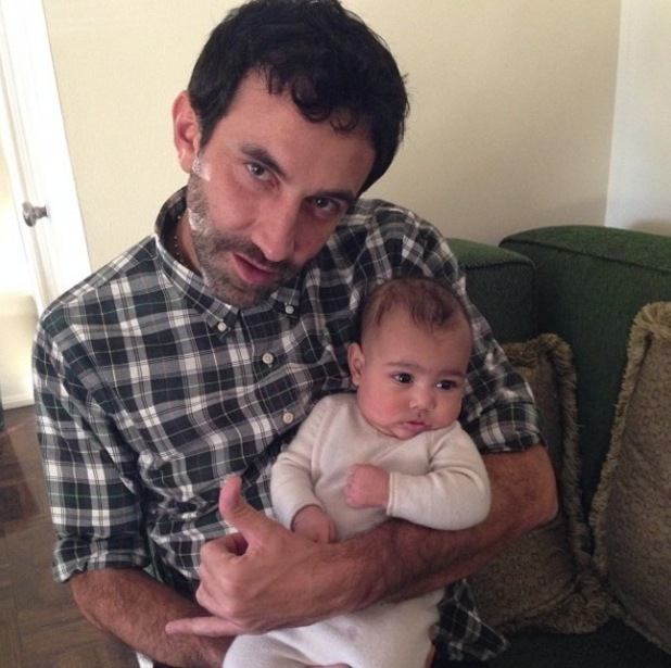 North West with fashion designer Riccardo Tisci