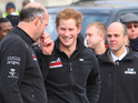 Young royal appears alongside his team of wounded servicemen in Trafalgar Square.