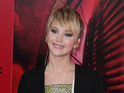 Hunger Games star also mocks the media's attention to her haircut.