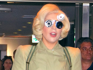 Lady Gaga arrives at Narita International Airport wearing a pair of wacky spectacles. The pop singer is in Japan to promote her new album 'ARTPOP'