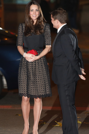 The Duchess of Cambridge walks with Tim Lawler (left), the chief executive of the charity, as she attends the SportsAid SportsBall gala dinner at Supernova, Embankment Gardens, London.