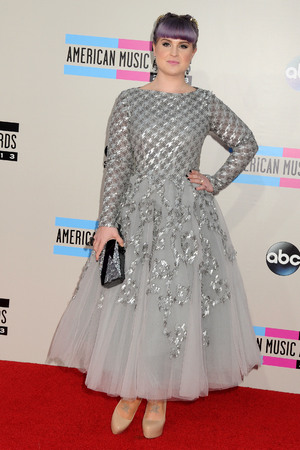 Kelly Osbourne arrives at the American Music Awards at the Nokia Theatre L.A. Live on Sunday, Nov. 24, 2013, in Los Angeles