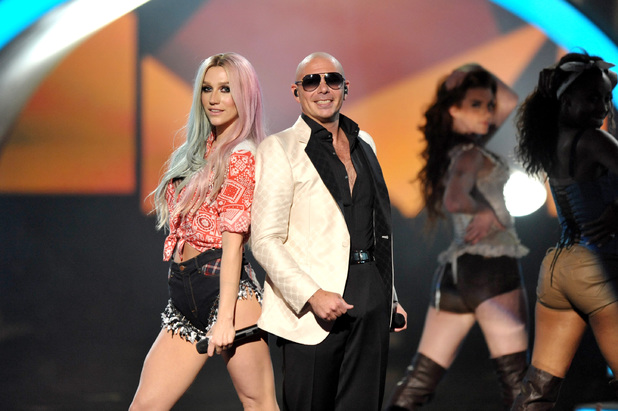 Ke$ha and Pitbull perform at the American Music Awards