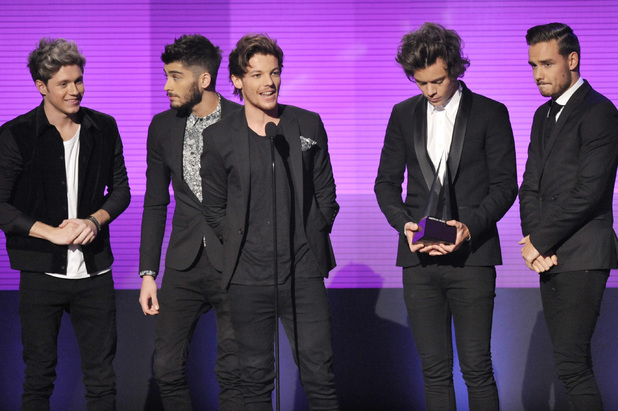 One Direction accept the award for favourite album - pop/rock for 'Take Me Home' at the American Music Awards