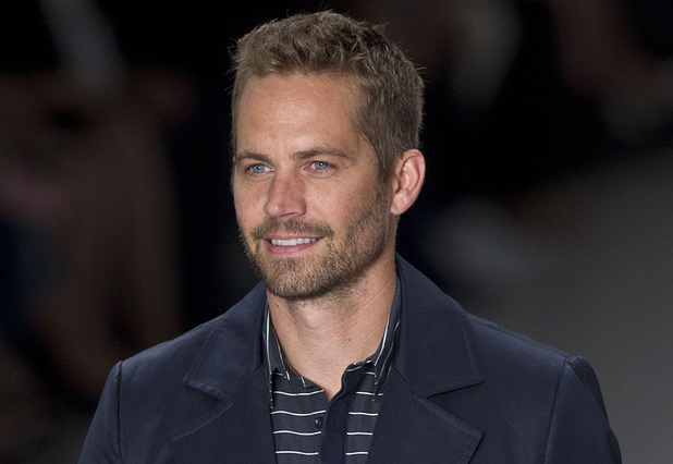 Paul Walker wears a creation from the Colcci summer collection at Sao Paulo Fashion Week