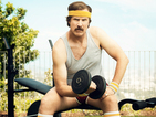 Will Ferrell's Ron Burgundy sculpts guns, poses with Baxter in shoot