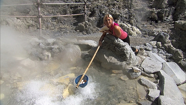 Amy hard boiling eggs in the volcanic spring in The Amazing Race: 'Cobra in My Teeth'